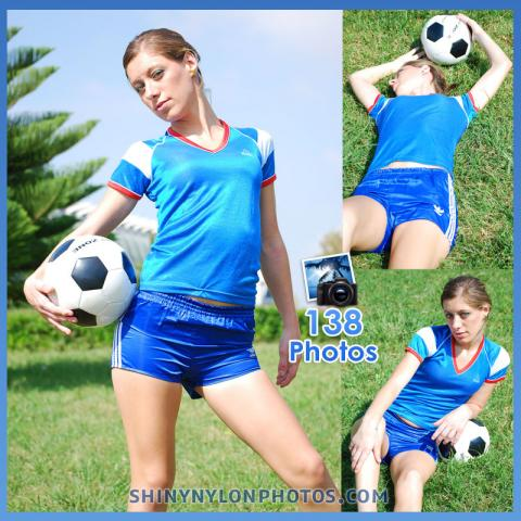 Blue shiny nylon shorts and blue t-shirt