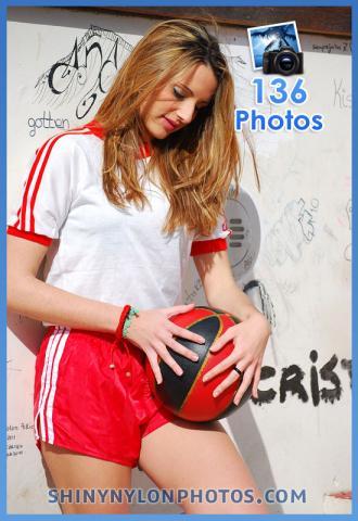 Red Adidas nylon shorts and white t-shirt