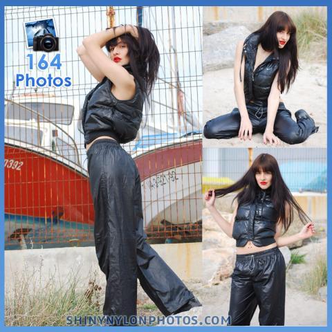 Shiny nylon black pant and and black nike puffy vest