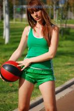 Green adidas nylon shorts and green t-shirt