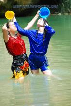 play in the lake in Blue sprinter nylon shorts and black shiny muay thai shorts