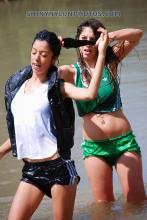 wetlook in black and green nylon shorts