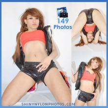 Black very shiny nylon shorts and orange top