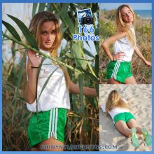 Green nylon shorts and white t-shirt
