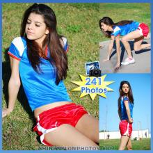 Red Puma nylon shorts and blue t-shirt