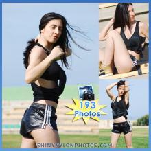 Black very shiny nylon shorts and black top