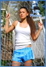 Light blue adidas nylon shorts and white t-shirt
