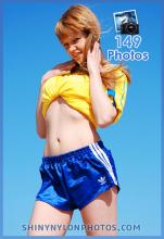 Blue shiny nylon shorts and yellow t-shirt
