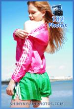 Green nylon shorts and pink nylon jacket