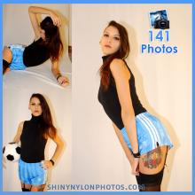 Light blue nylon shorts and black top