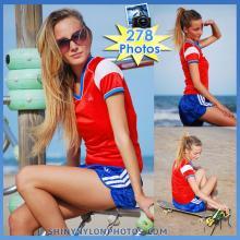 Blue nylon Sprinter shorts and red nylon t-shirt.