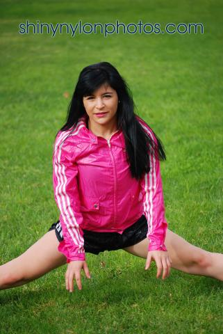 Black adidas sprinter nylon shorts and pink nylon jacket