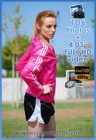 Black puma nylon shorts and pink nylon jacket