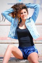 Shiny nylon darkblue shorts and blue jeans jacket