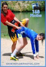 Blue sprinter nylon shorts and black shiny muay thai shorts