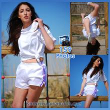 White adidas nylon shorts with purple stripes