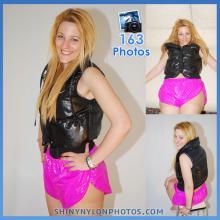 Pink nylon shorts and black nike puffy vest.