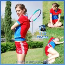 Red Adidas nylon shorts and red t-shirt