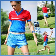 Light blue nylon shorts and red t-shirt